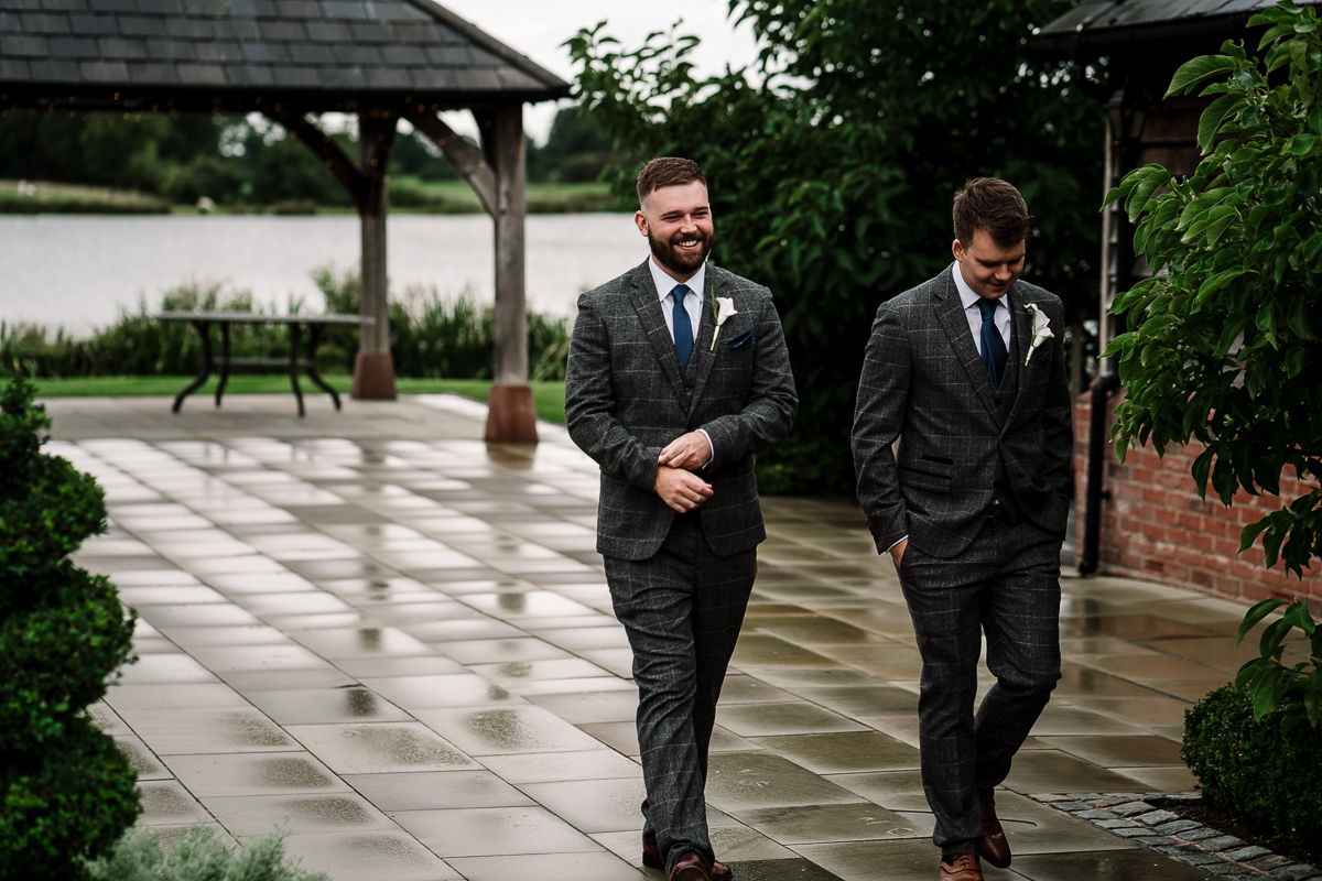 Groom and best man walking into venue