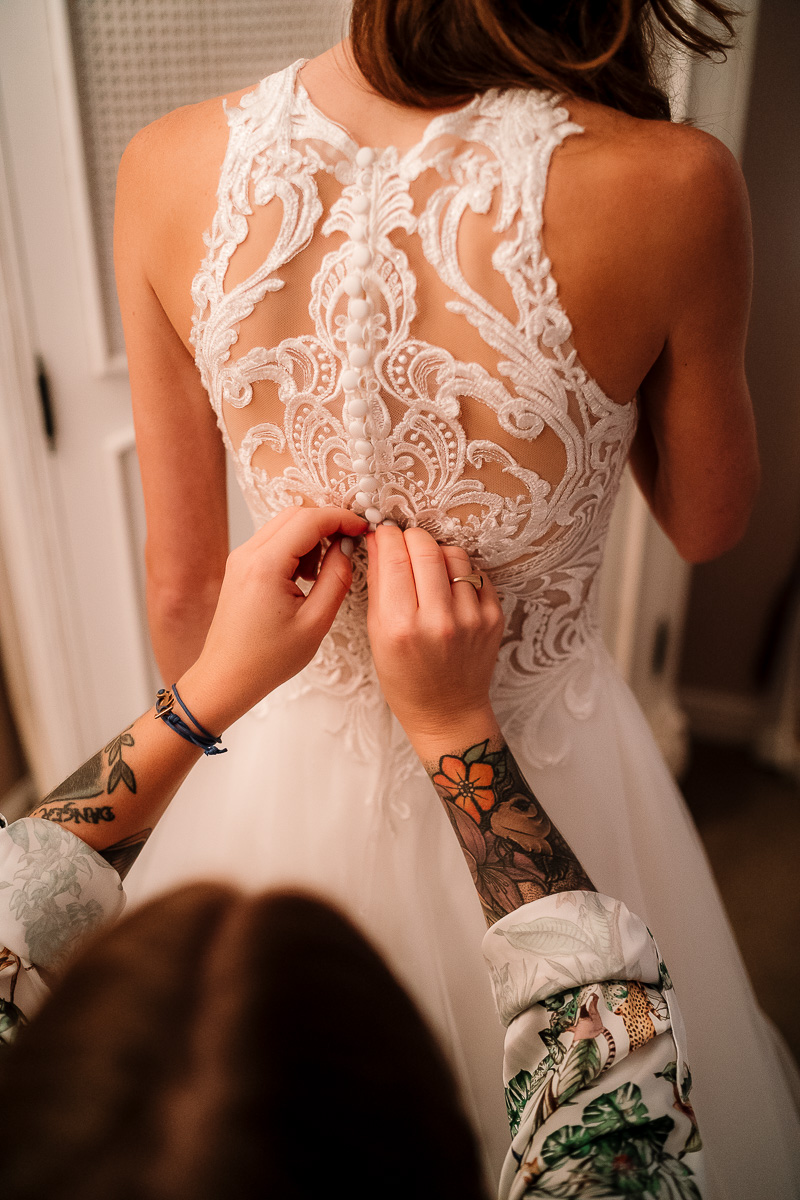 Brides dress being done up
