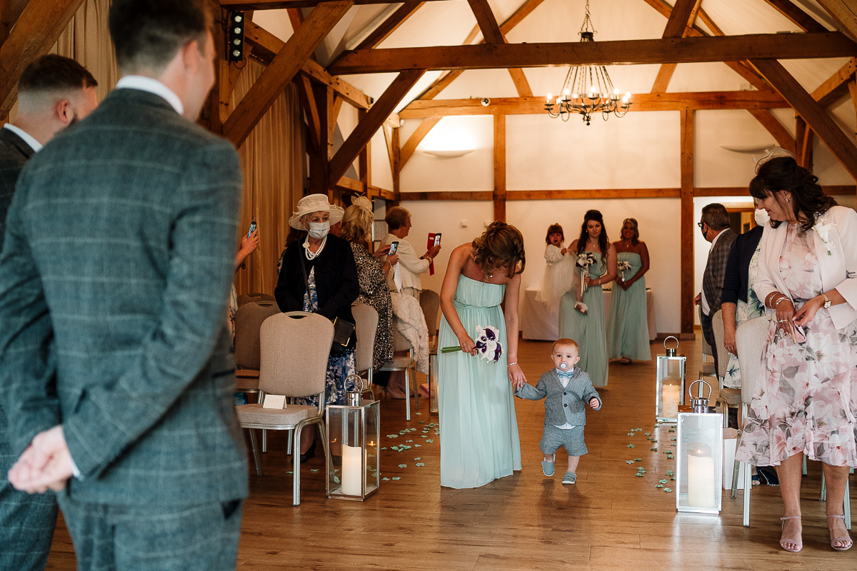 Pageboy walking down the aisle
