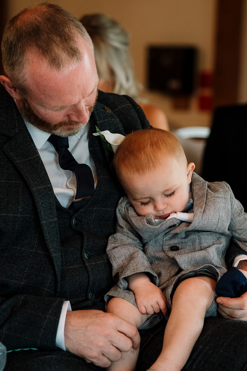 Pageboy asleep in ceremony