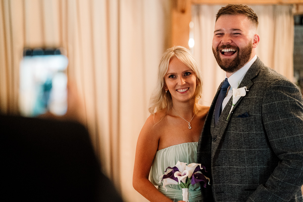 Best man and bridesmaid laughing