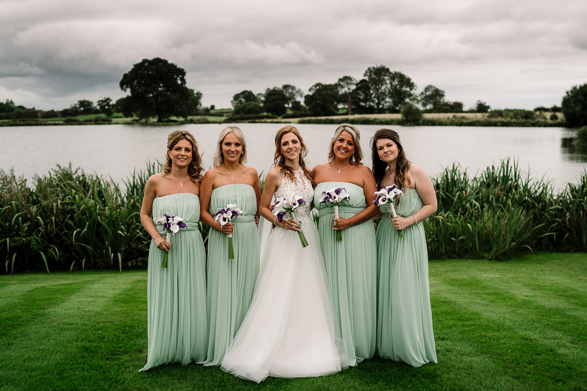 Bride and bridemaids by the lake