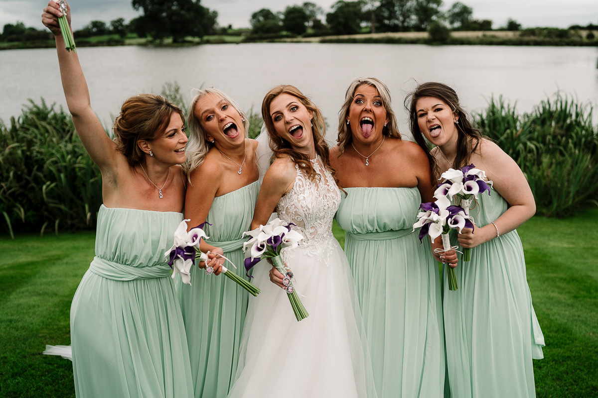 Bride and bridesmaids pulling funny faces