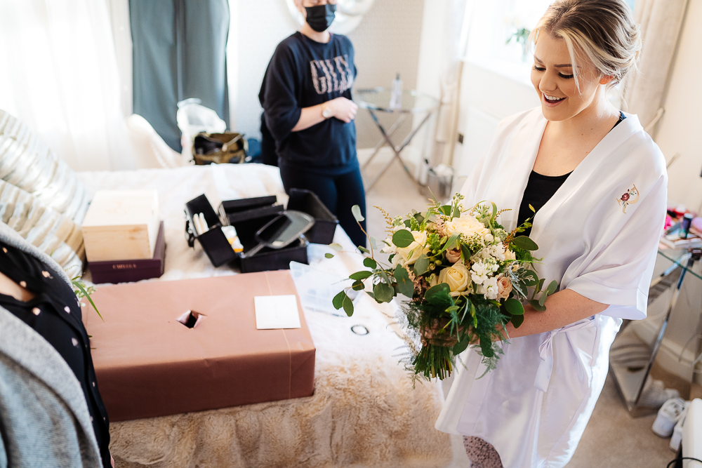 bride's flowers being presented by the florist