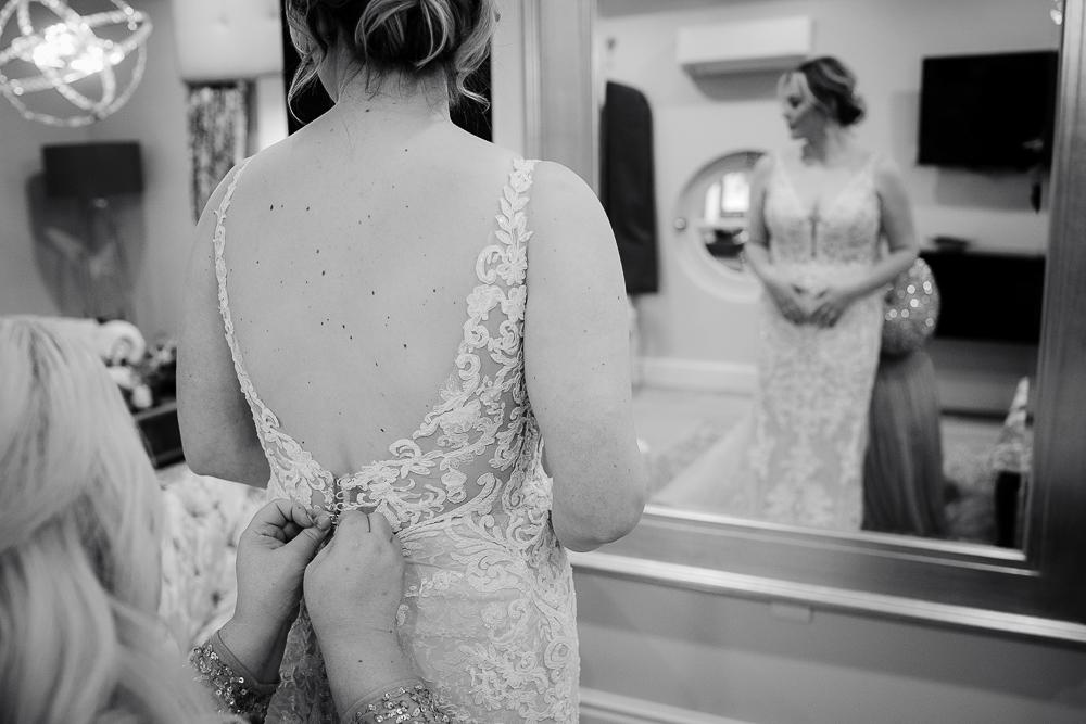 Bride's dress being fastened