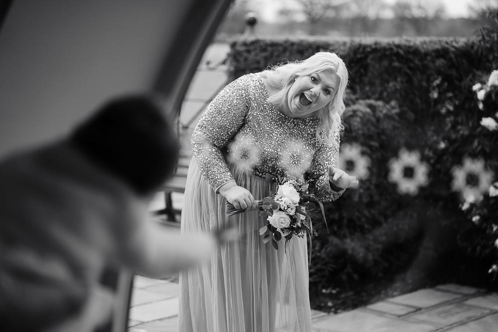 bridesmaid playing peekaboo with flower girl