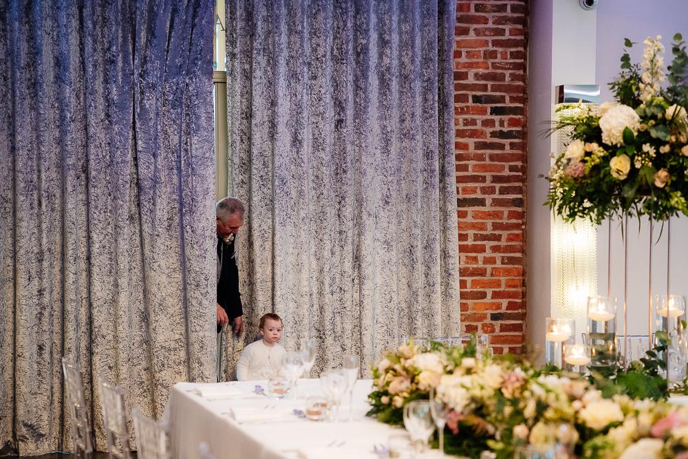 Flower girl peeking at Merrydale suite