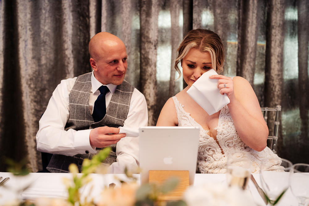 bride crying watching video messages