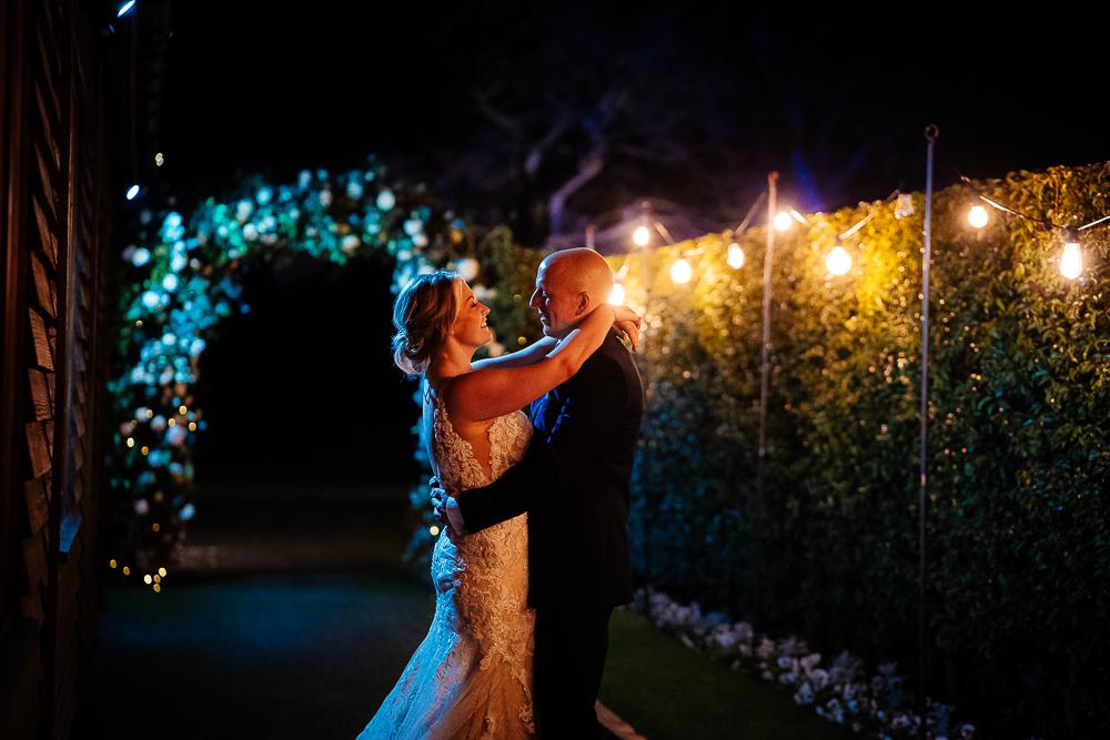 bride and groom at night with festoon lighting