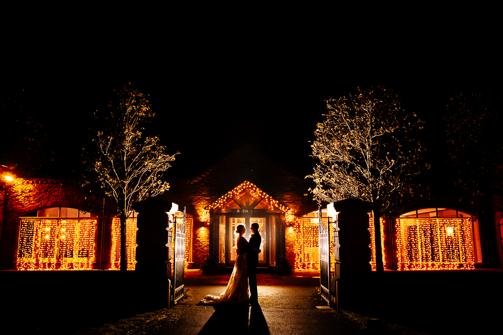 silhouette of bride and groom outside Merrydale Manor