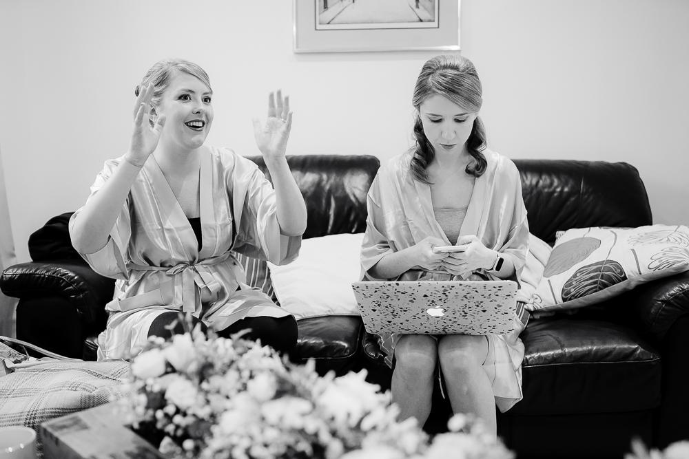 bridesmaids sat on sofa