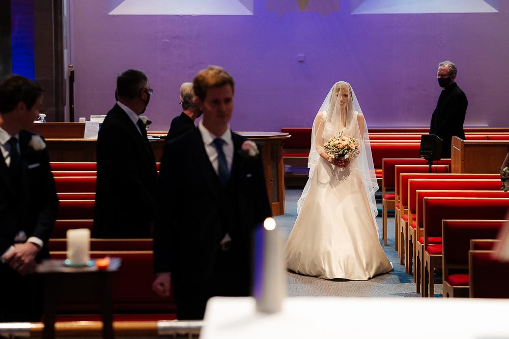 bride walking down aisle alone