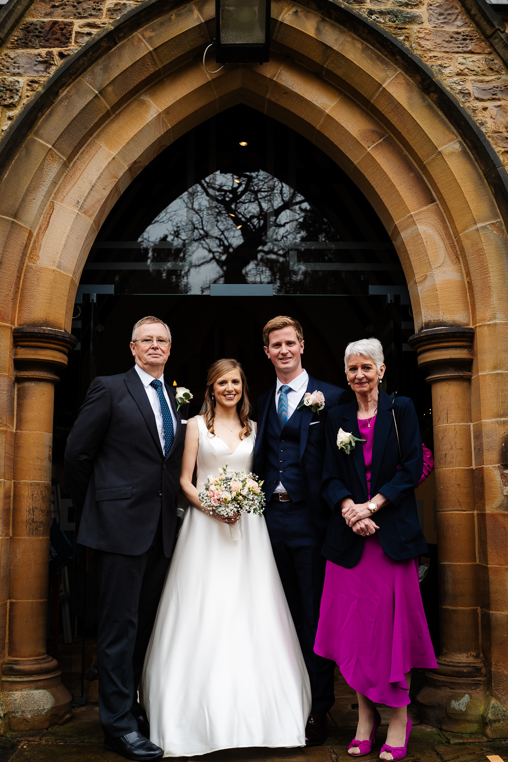bride and groom with groom's parents