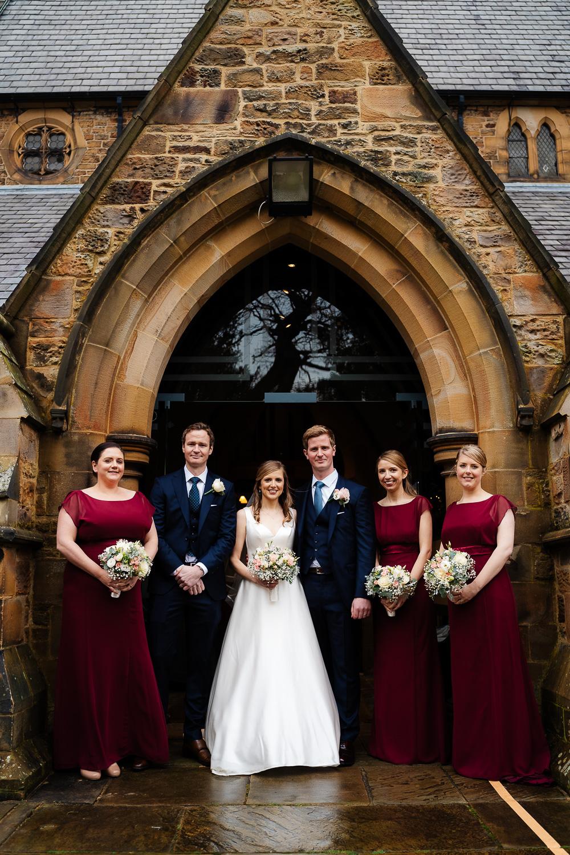 bridal party in church doorway