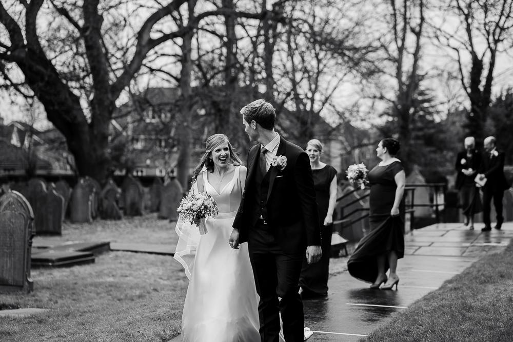 bride and groom walking down church path