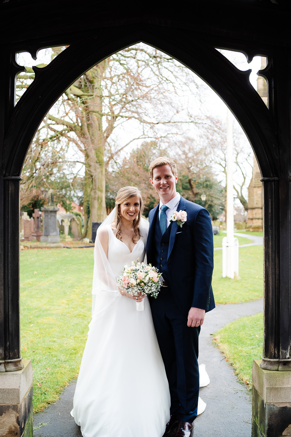 bride and groom by lych gate