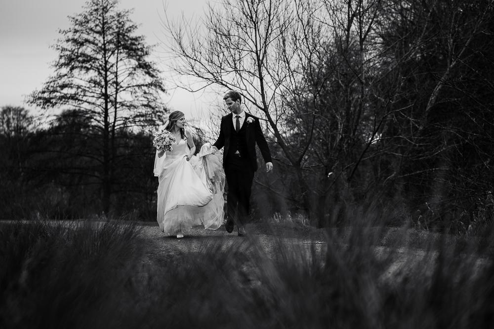 bride and groom walking towards poynton pool